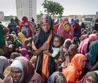 Somalis forced to flee their homes wait for food distribution in Mogadishu, Somalia
